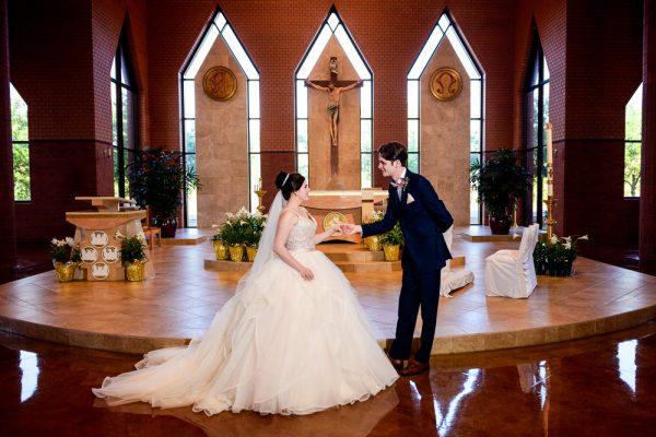 Groom taking Bride's hand in their church, black and white, Romantic Catholic Wedding, Pensacola Florida Wedding Photographer, Lazzat Photography