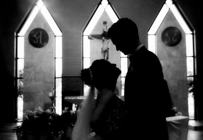 Close up of Bride and Groom looking at each other in their church, black and white, Romantic Catholic Wedding, Pensacola Florida Wedding Photographer, Lazzat Photography