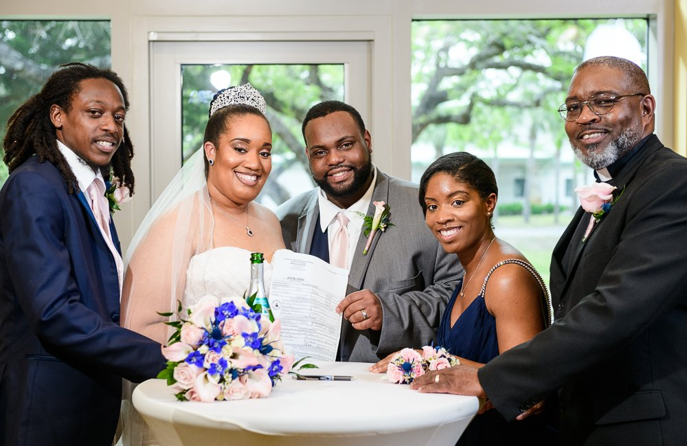 Bride and Groom with their officiant and witnesses to their marriage certificate, Blue and Pink Wedding, The Soundside Club, Elegant Ballroom Wedding, Lazzat Photography, Florida Wedding Photography