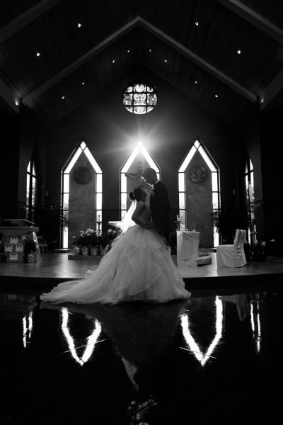 Bride and Groom looking at each other in their church, black and white, Romantic Catholic Wedding, Pensacola Florida Wedding Photographer, Lazzat Photography