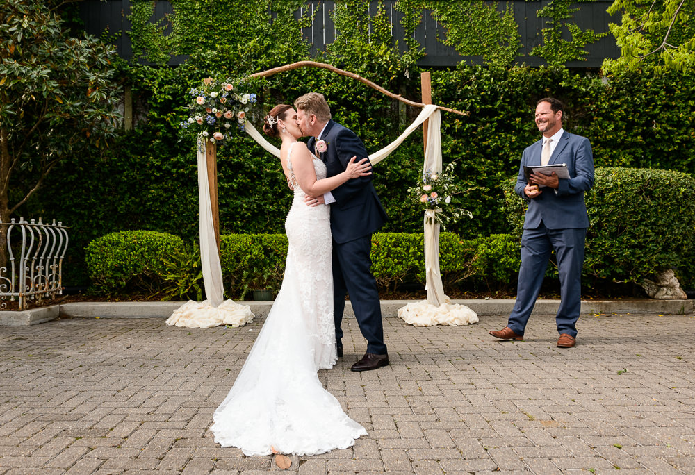 Bride and Groom's first kiss, 5Eleven Palafox, Classic Pensacola Wedding, Lazzat Photography, Florida Wedding Photographer