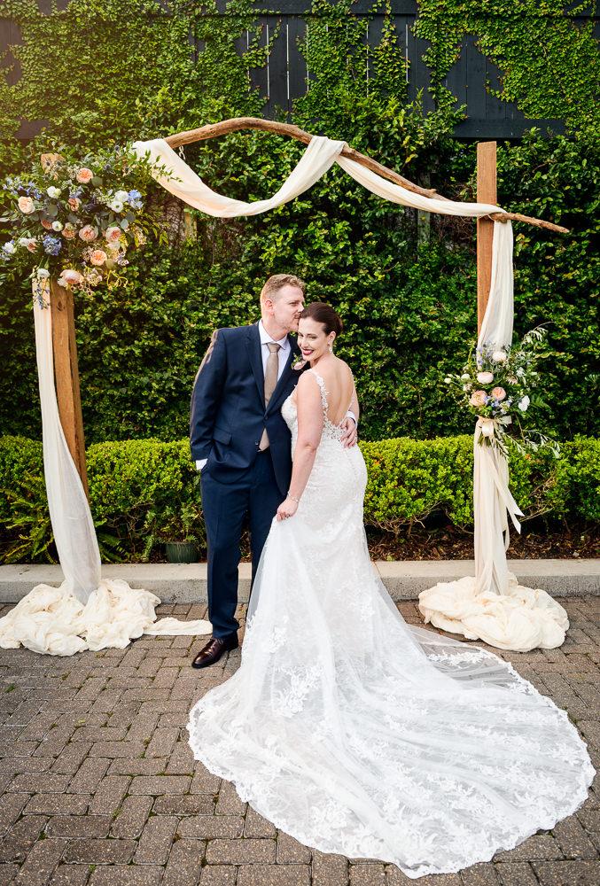 Groom kissing Bride on the head at 5Eleven Palafox, Classic Pensacola Wedding, Lazzat Photography, Florida Wedding Photographer