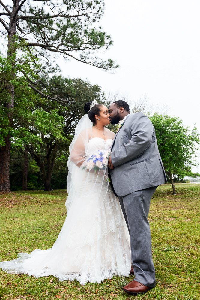 Bride and Groom kissing outside facing the camera, Blue and Pink Wedding, The Soundside Club, Elegant Ballroom Wedding, Lazzat Photography, Florida Wedding Photography