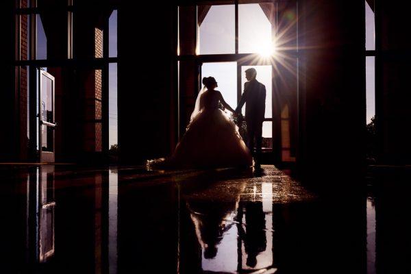 Silhouette of Bride and Groom leaving the church, Romantic Catholic Wedding, Pensacola Florida Wedding Photographer, Lazzat Photography