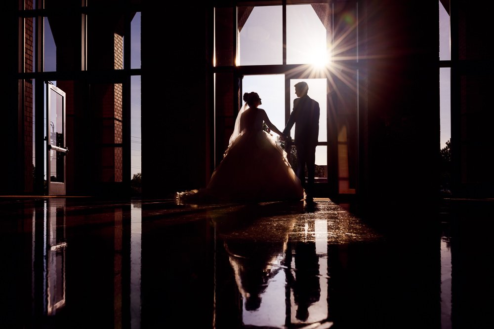 Silhouette of Bride and Groom leaving the church, Romantic Catholic Wedding, Pensacola Florida Wedding Photographer, Lazzat Photography