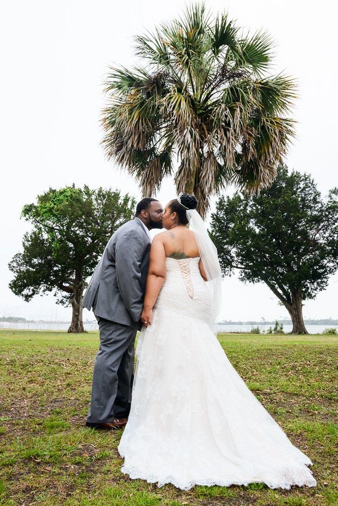 Bride and Groom kissing outside, Blue and Pink Wedding, The Soundside Club, Elegant Ballroom Wedding, Lazzat Photography, Florida Wedding Photography