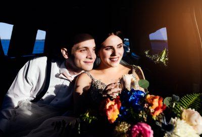 Bride and Groom inside their limo, Romantic Catholic Wedding, Pensacola Florida Wedding Photographer, Lazzat Photography