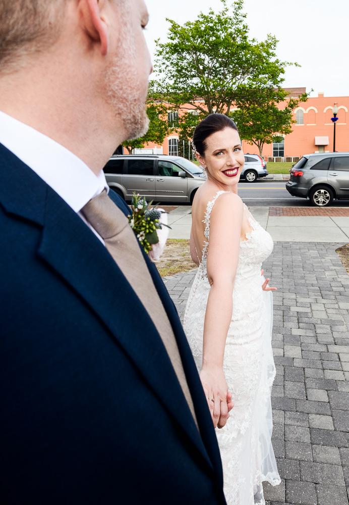 Bride Leading Groom downtown Pensacola, Classic Pensacola Wedding, Lazzat Photography, Florida Wedding Photographer