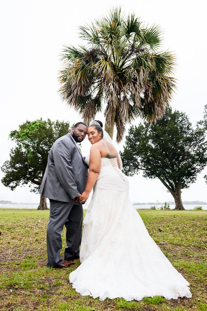 Bride and Groom looking back at the camera, Blue and Pink Wedding, The Soundside Club, Elegant Ballroom Wedding, Lazzat Photography, Florida Wedding Photography