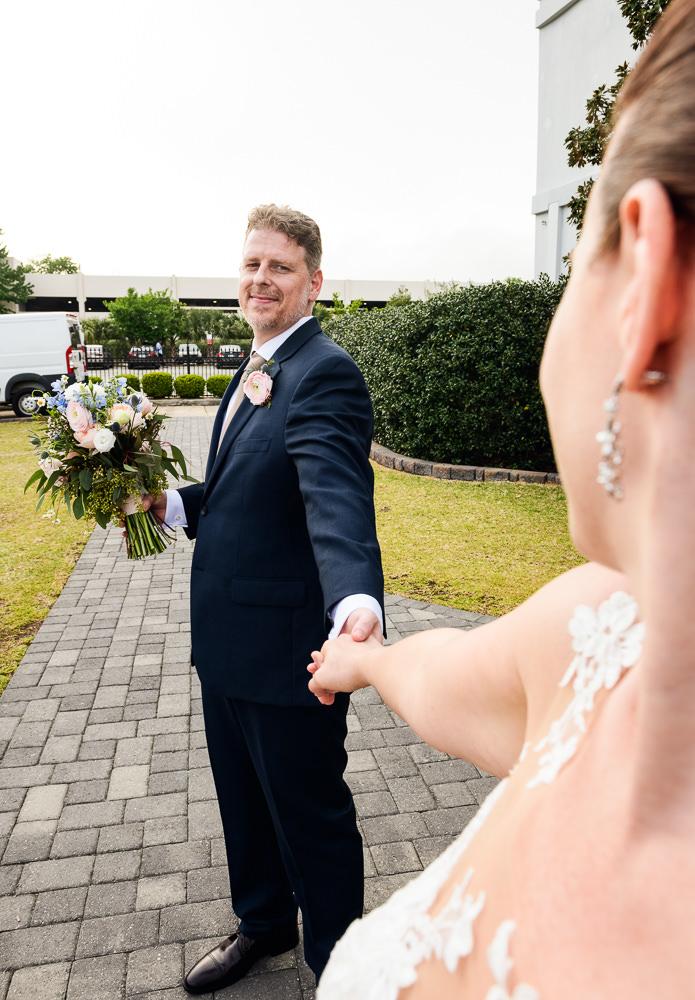 Groom leading Bride downtown Pensacola, Classic Pensacola Wedding, Lazzat Photography, Florida Wedding Photographer