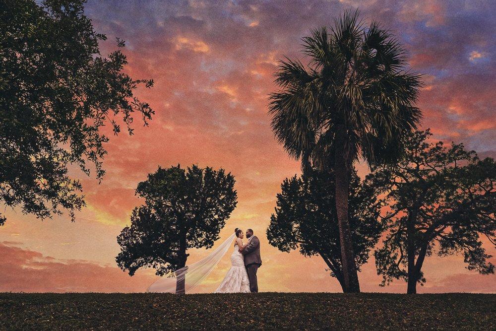 Bride and Groom with epic sunset, Blue and Pink Wedding, The Soundside Club, Elegant Ballroom Wedding, Lazzat Photography, Florida Wedding Photography