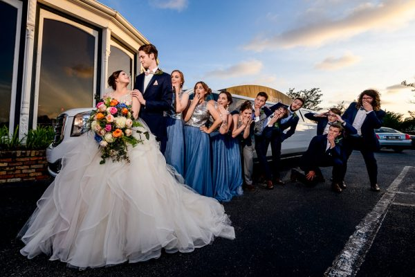 Bride and Groom with their wedding party looking surprised by their limo, Romantic Catholic Wedding, Pensacola Florida Wedding Photographer, Lazzat Photography