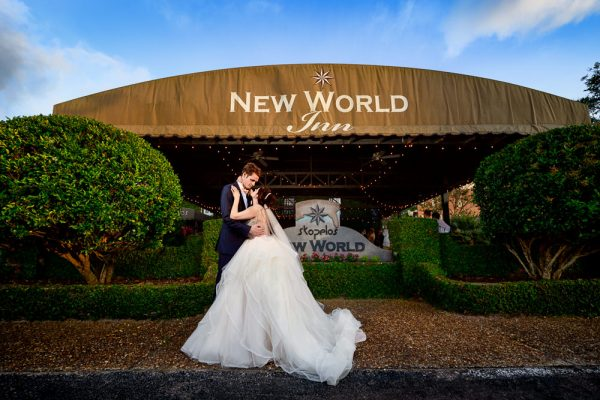 Bride and Groom looking at each other outside their reception venue, New world inn, Romantic Catholic Wedding, Pensacola Florida Wedding Photographer, Lazzat Photography