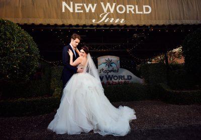 Bride and Groom outside their reception venue, New world inn, Romantic Catholic Wedding, Pensacola Florida Wedding Photographer, Lazzat Photography