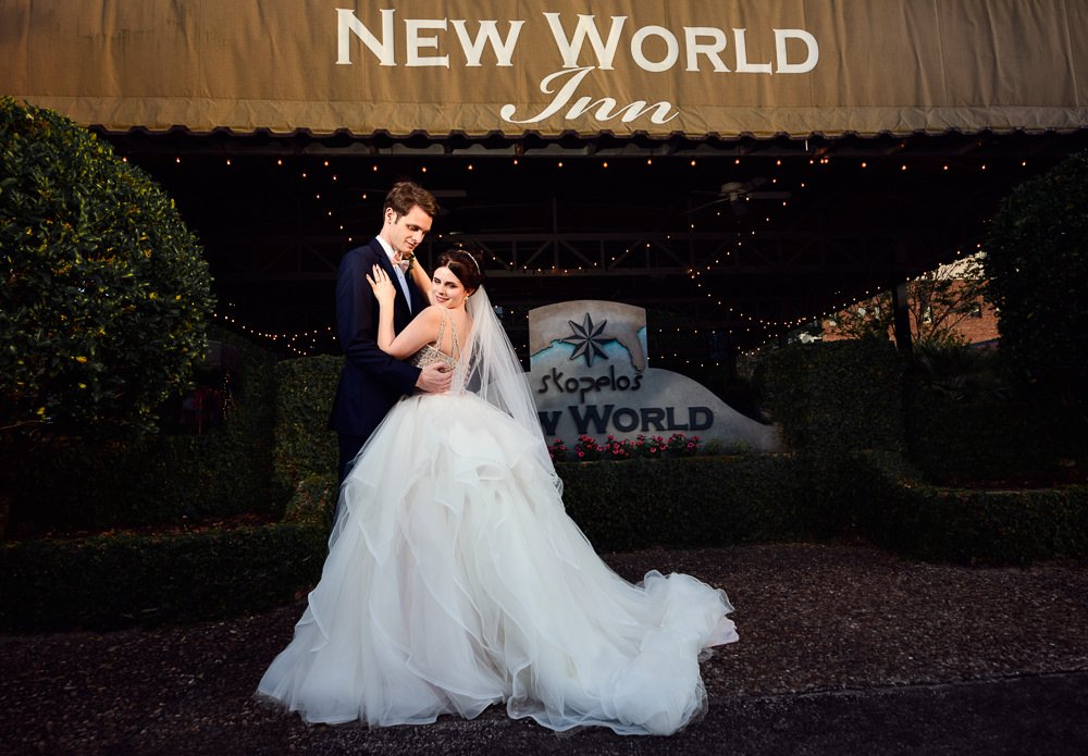 Bride and Groom outside their reception venue, New world inn, Romantic Catholic Wedding, Pensacola Florida Wedding Photographer, Lazzat Photography