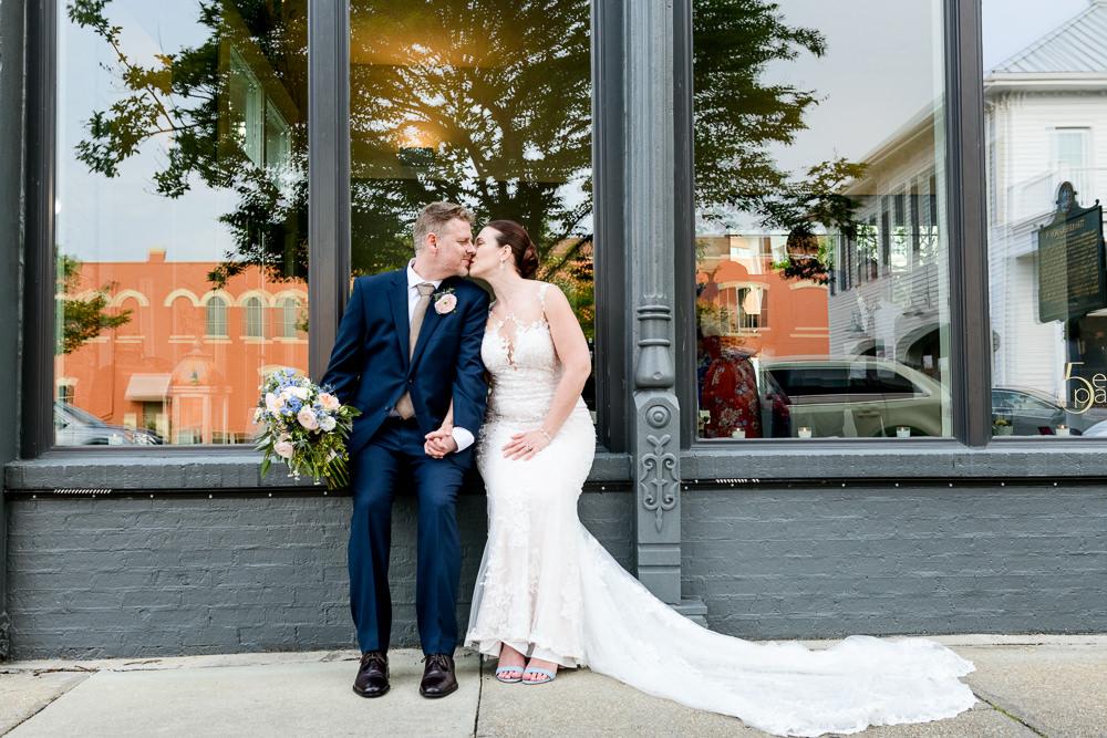 Bride and Groom kissing outside of 5Eleven Palafox, Classic Pensacola Wedding, Lazzat Photography, Florida Wedding Photographer