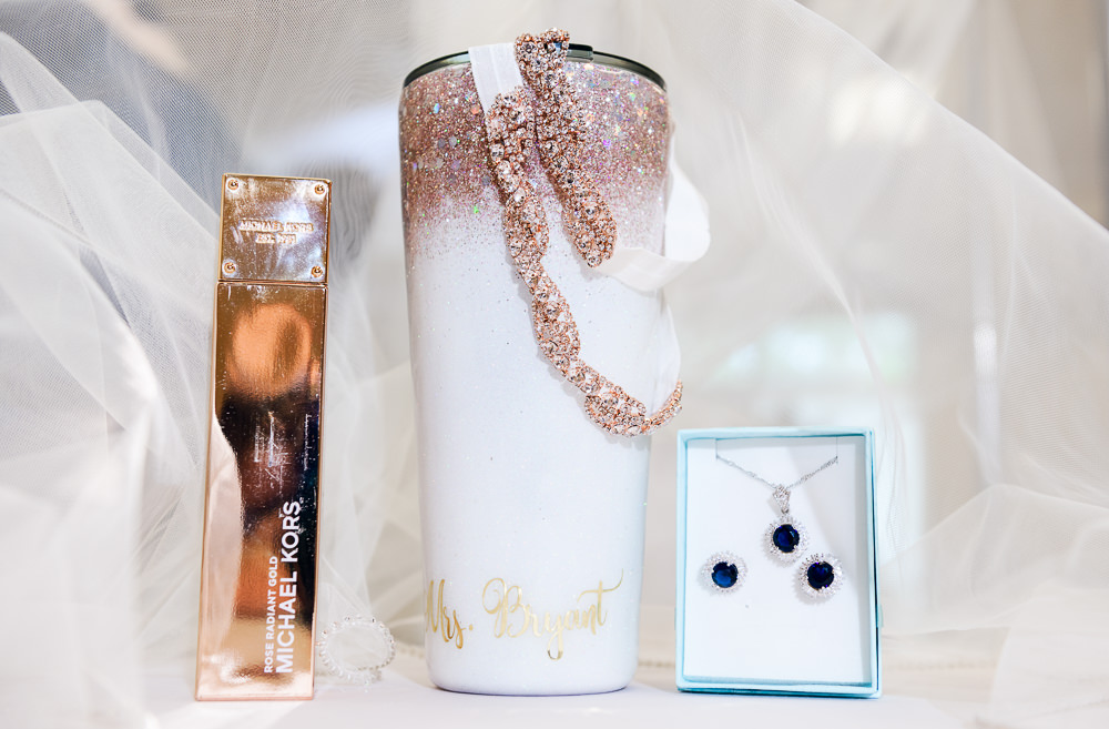Bride's details, glitter mug, sapphire earrings and necklace, Blue and Pink Wedding, The Soundside Club, Elegant Ballroom Wedding, Lazzat Photography, Florida Wedding Photography