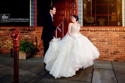 Bride looking back at Groom as they walk down the street, Romantic Catholic Wedding, Pensacola Florida Wedding Photographer, Lazzat Photography