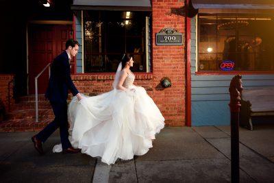 Groom carrying Bride's train for her, Romantic Catholic Wedding, Pensacola Florida Wedding Photographer, Lazzat Photography