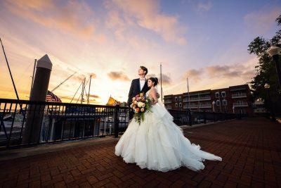 Bride and Groom at sunset with sailboats, Romantic Catholic Wedding, Pensacola Florida Wedding Photographer, Lazzat Photography