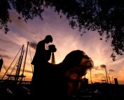Bride and Groom silhouette at sunset with sailboats, Romantic Catholic Wedding, Pensacola Florida Wedding Photographer, Lazzat Photography