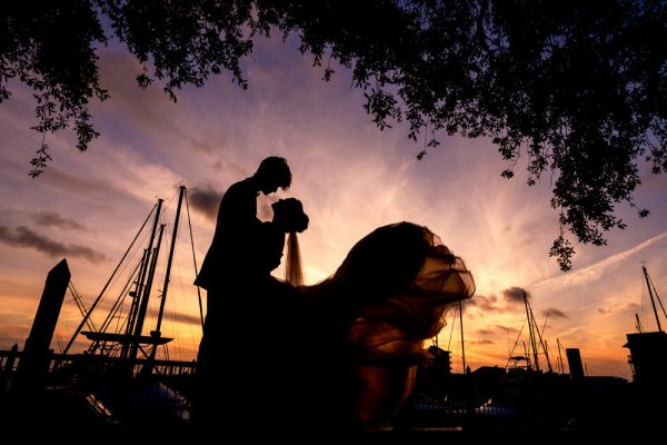 Bride and Groom silhouette at sunset with sailboats, Romantic Catholic Wedding, Pensacola Florida Wedding Photographer, Lazzat Photography