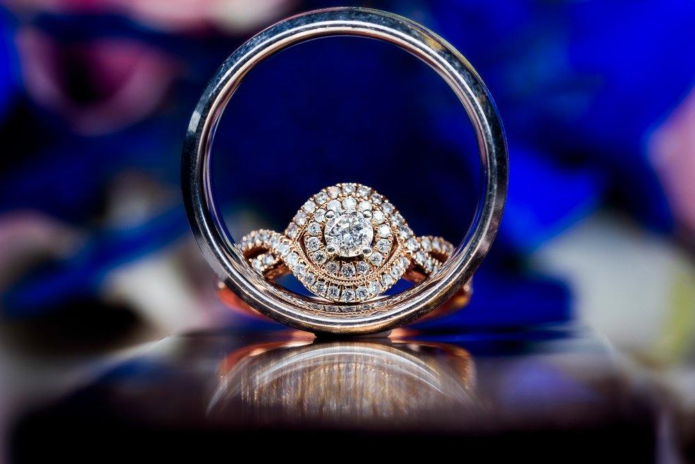Wedding rings with reflection, Blue and Pink Wedding, The Soundside Club, Elegant Ballroom Wedding, Lazzat Photography, Florida Wedding Photography