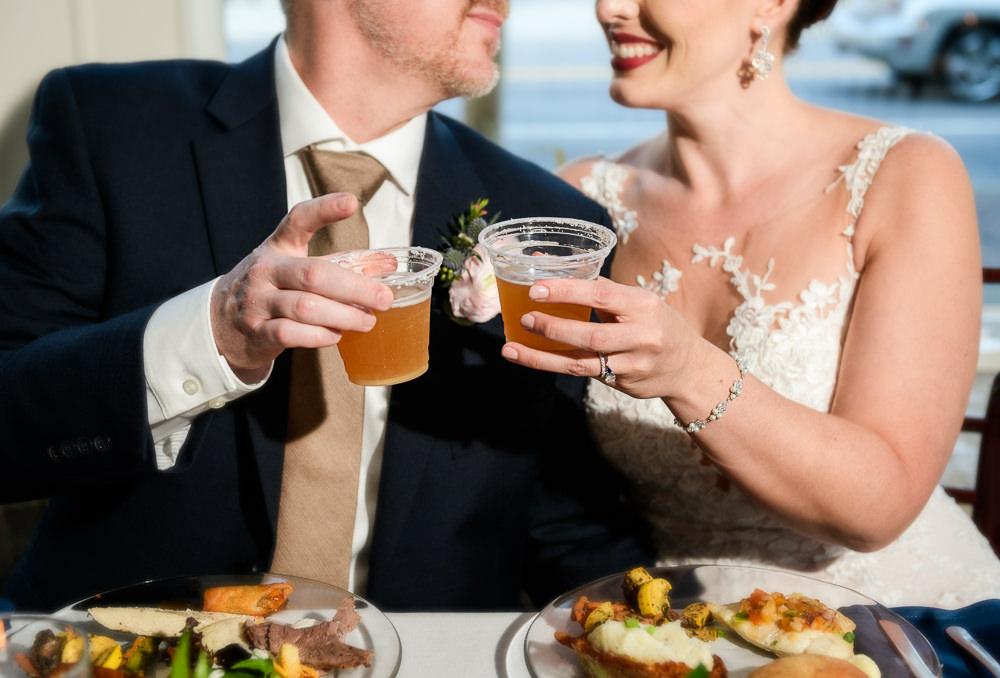 Bride and Groom cheers, 5Eleven Palafox, Classic Pensacola Wedding, Lazzat Photography, Florida Wedding Photographer
