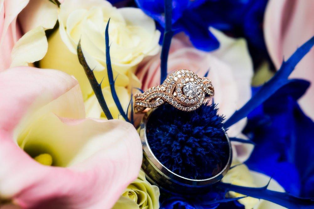 Wedding rings on flowers, Blue and Pink Wedding, The Soundside Club, Elegant Ballroom Wedding, Lazzat Photography, Florida Wedding Photography