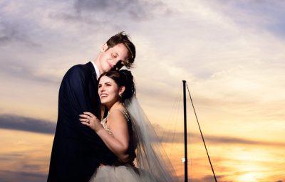 Bride and Groom hugging at sunset, Romantic Catholic Wedding, Pensacola Florida Wedding Photographer, Lazzat Photography