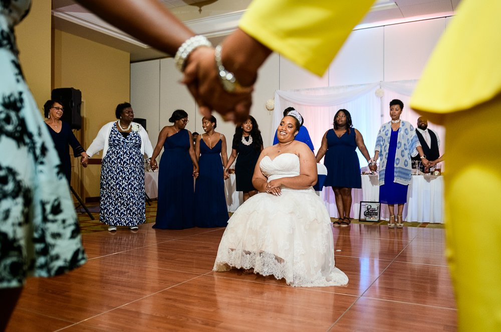 Close up of Bride being sung to by her sorority sisters, Zeta Phi Beta Sorority Incorporated, Blue and Pink Wedding, The Soundside Club, Elegant Ballroom Wedding, Lazzat Photography, Florida Wedding Photography