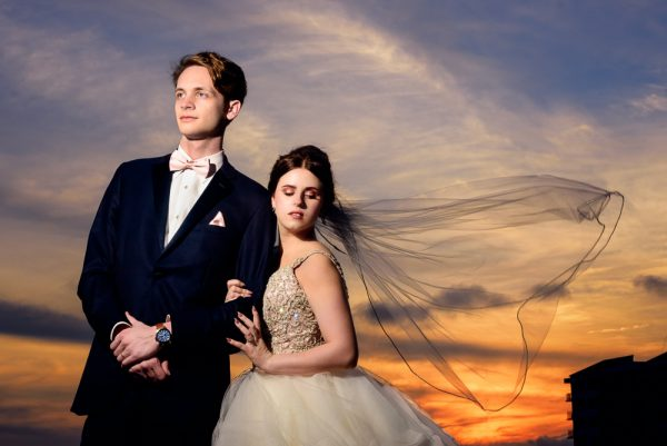 Bride and Groom at sunset with veil blowing in the wind, Romantic Catholic Wedding, Pensacola Florida Wedding Photographer, Lazzat Photography