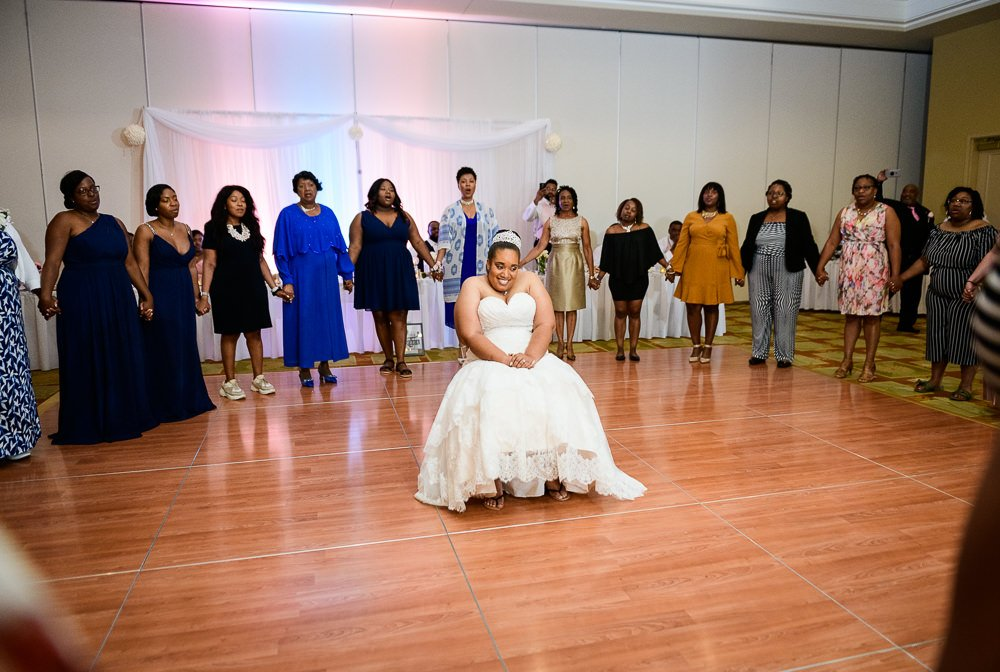 Bride being sung to by her sorority sisters, Zeta Phi Beta Sorority Incorporated, Blue and Pink Wedding, The Soundside Club, Elegant Ballroom Wedding, Lazzat Photography, Florida Wedding Photography