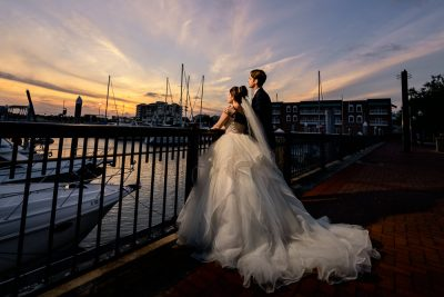 Bride and Groom looking out over the water on the railing at sunset, Romantic Catholic Wedding, Pensacola Florida Wedding Photographer, Lazzat Photography