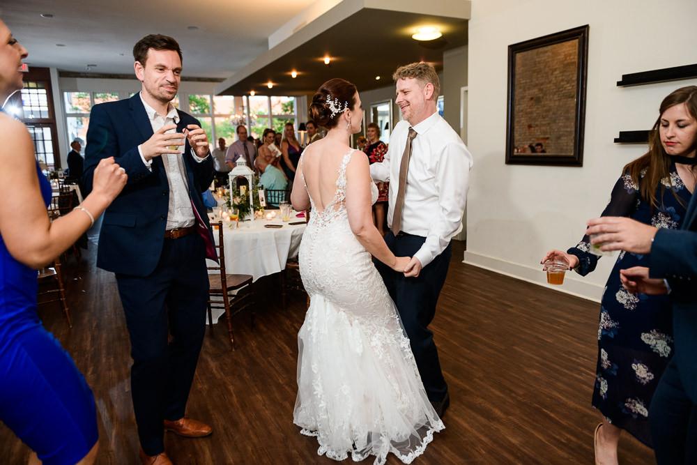 Bride and Groom dancing at wedding reception, 5Eleven Palafox, Classic Pensacola Wedding, Lazzat Photography, Florida Wedding Photographer