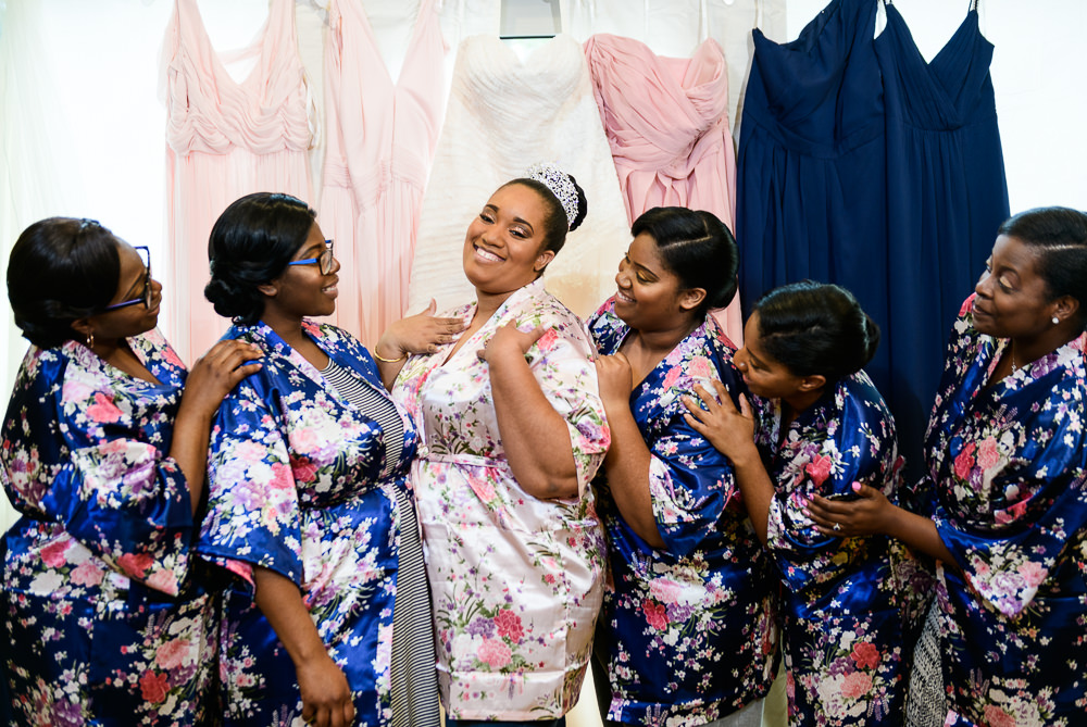 Bride and Bridesmaids in their floral robes, Blue and Pink Wedding, The Soundside Club, Elegant Ballroom Wedding, Lazzat Photography, Florida Wedding Photography
