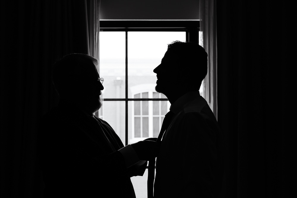 Silhouette of Groom and his dad, black and white, Holiday Inn Express Pensacola Downtown, Classic Pensacola Wedding, Lazzat Photography, Florida Wedding Photographer