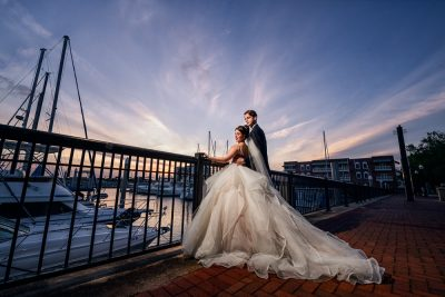 Bride and Groom looking out over the water on the railing, Romantic Catholic Wedding, Pensacola Florida Wedding Photographer, Lazzat Photography