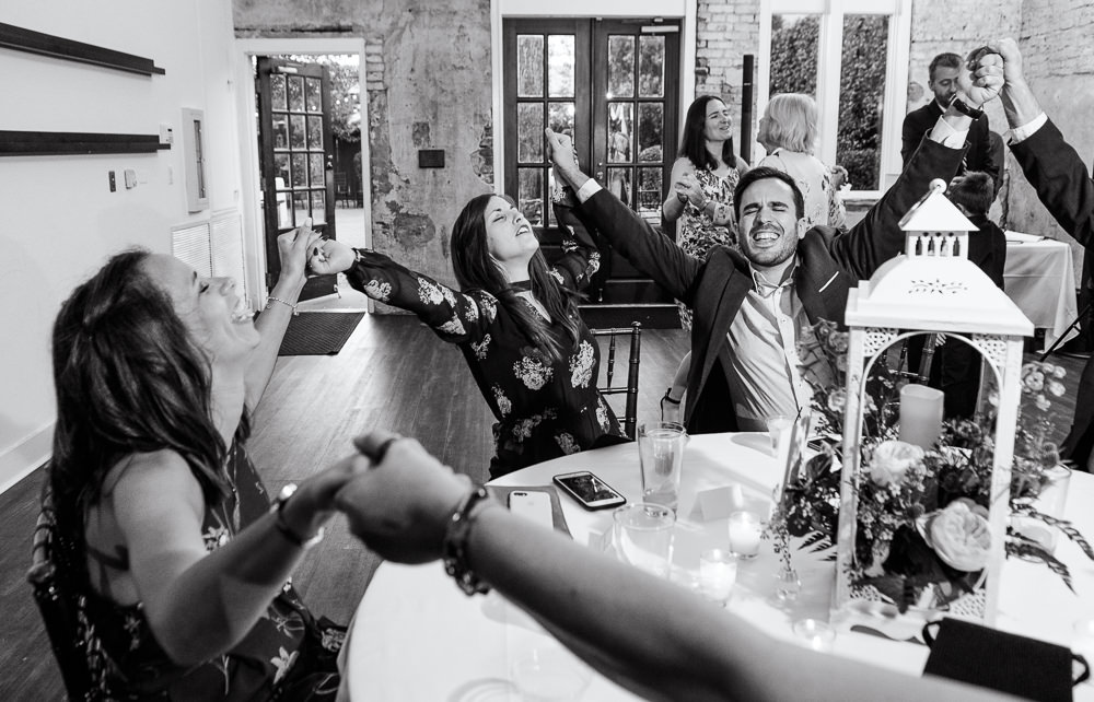 Guests singing along to music at wedding reception, 5Eleven Palafox, Classic Pensacola Wedding, Lazzat Photography, Florida Wedding Photographer
