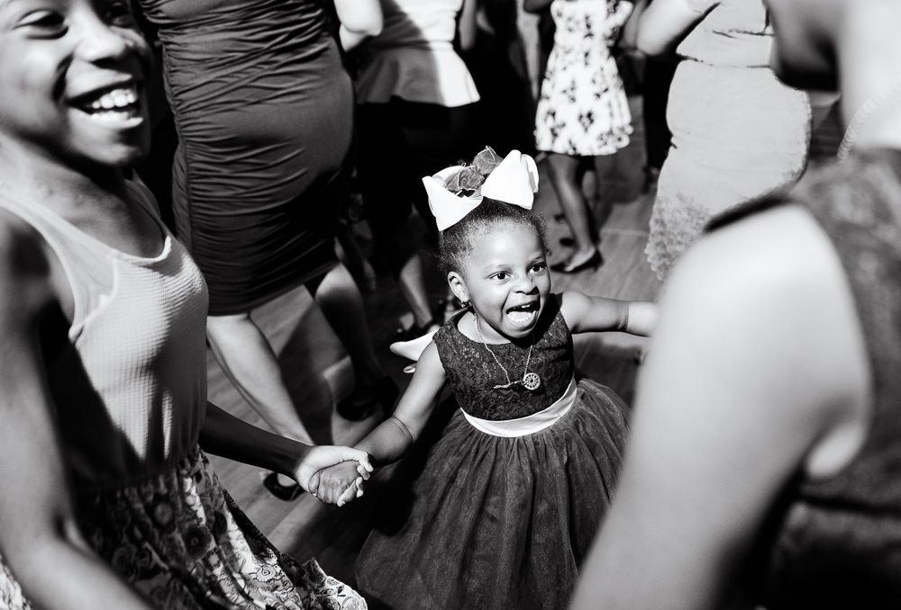Flower girl dancing, black and white, Blue and Pink Wedding, The Soundside Club, Elegant Ballroom Wedding, Lazzat Photography, Florida Wedding Photography