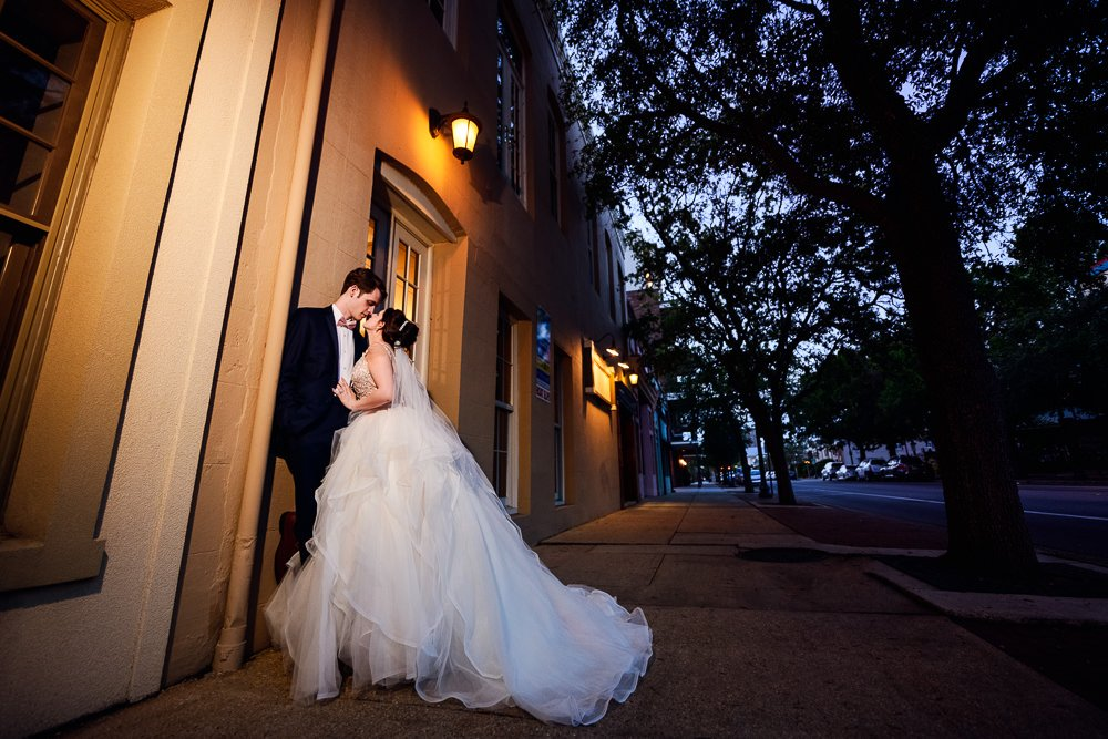 Bride and Groom leaning against a wall downtown, Romantic Catholic Wedding, Pensacola Florida Wedding Photographer, Lazzat Photography