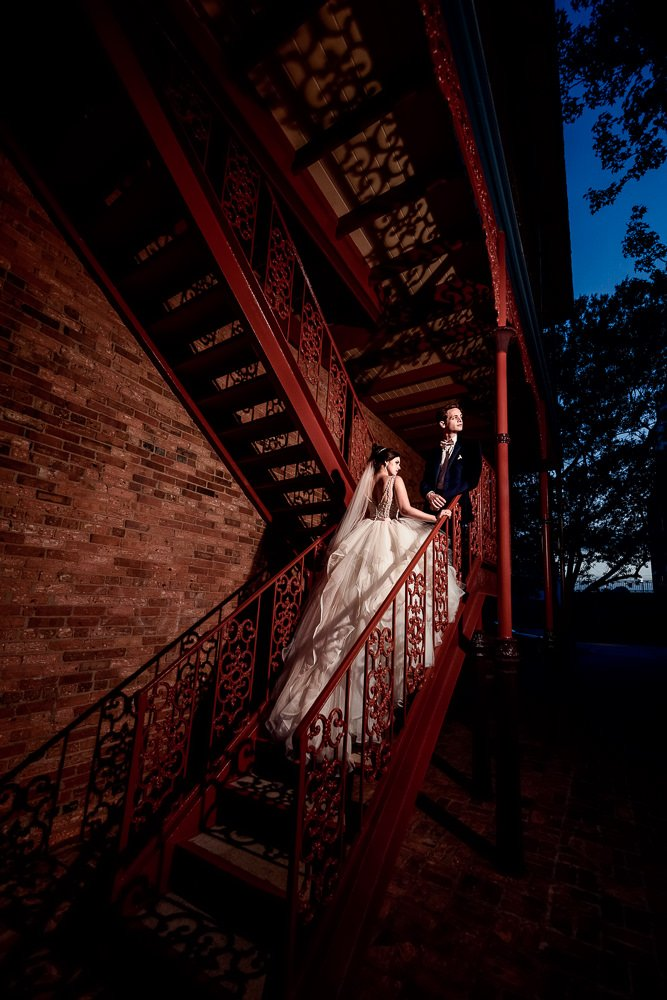 Bride and Groom looking out on the red stairs, Romantic Catholic Wedding, Pensacola Florida Wedding Photographer, Lazzat Photography