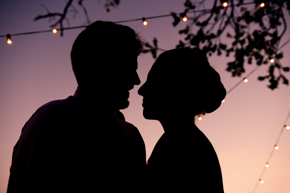 Silhouette of Bride and Groom at sunset, 5Eleven Palafox, Classic Pensacola Wedding, Lazzat Photography, Florida Wedding Photographer