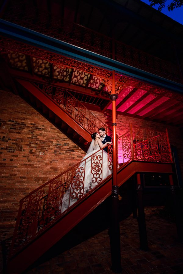 Bride and Groom on the red stairs, Romantic Catholic Wedding, Pensacola Florida Wedding Photographer, Lazzat Photography