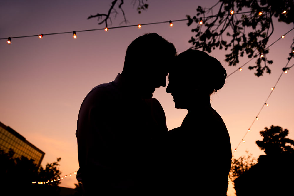Silhouette of Bride and Groom head to head at sunset, 5Eleven Palafox, Classic Pensacola Wedding, Lazzat Photography, Florida Wedding Photographer