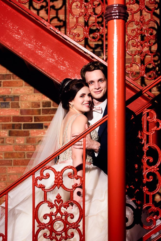 Bride and Groom close up on the red stairs, Romantic Catholic Wedding, Pensacola Florida Wedding Photographer, Lazzat Photography