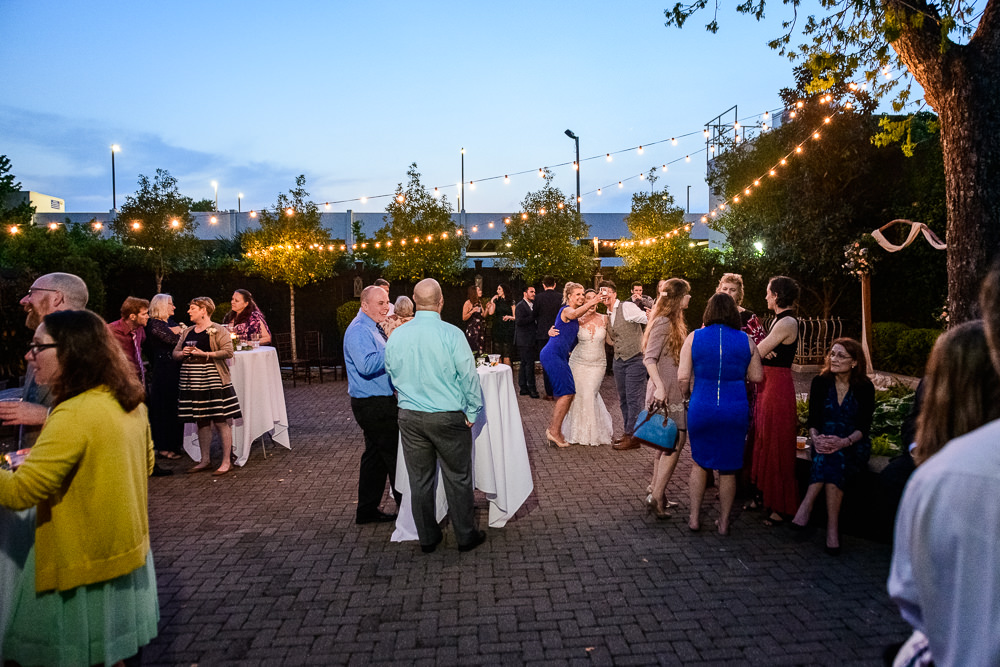 Guests outside during happy hour, 5Eleven Palafox, Classic Pensacola Wedding, Lazzat Photography, Florida Wedding Photographer