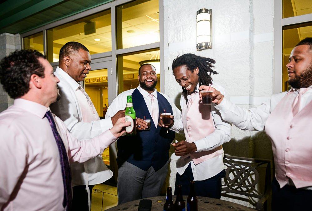 Groom toasting with his groomsmen, Blue and Pink Wedding, The Soundside Club, Elegant Ballroom Wedding, Lazzat Photography, Florida Wedding Photography