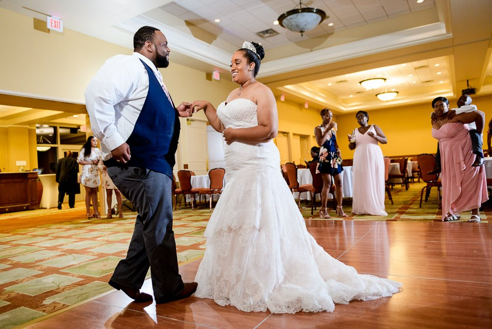 Bride and Groom dancing during their wedding, Blue and Pink Wedding, The Soundside Club, Elegant Ballroom Wedding, Lazzat Photography, Florida Wedding Photography