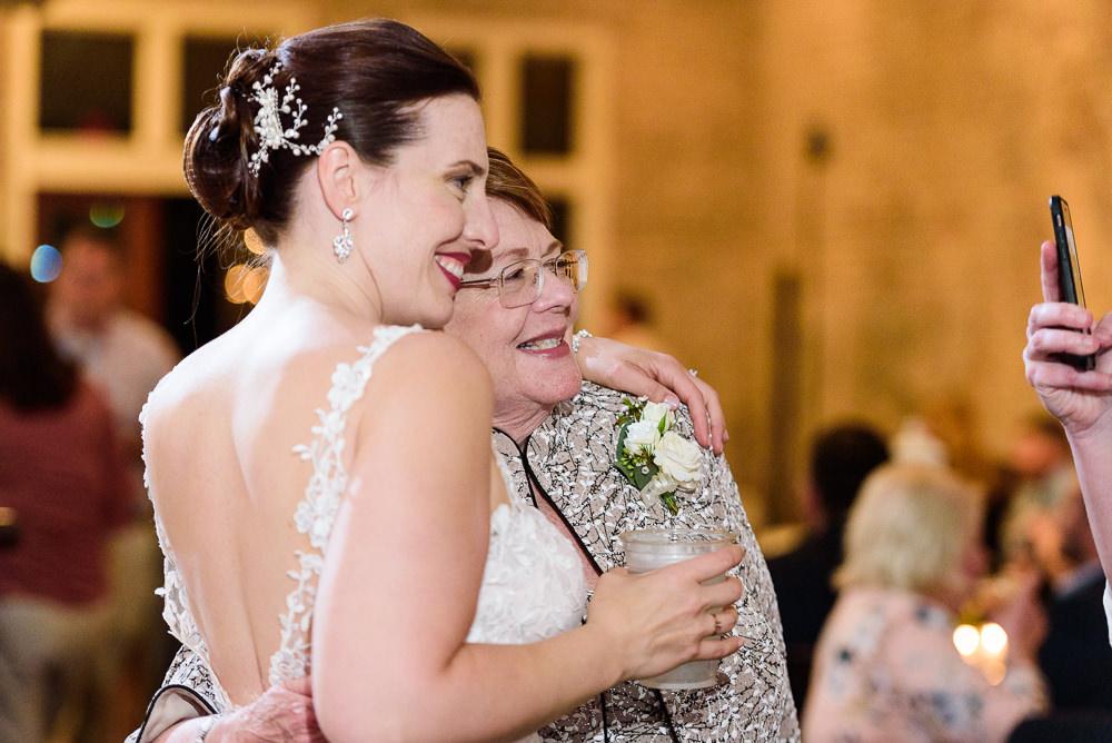 Bride and mom having their photo taken, 5Eleven Palafox, Classic Pensacola Wedding, Lazzat Photography, Florida Wedding Photographer